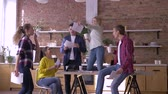 brainstorm : office party, crazy creative team of workers men and women having fun while job in kitchen in modern office and throwing documents into air