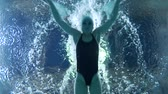 plavec : Professional swimmer girl floating in blue water Poolside during training before competition, underwater view