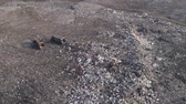 teherautó : environmental pollution problem, drone view on people work at a dump near trucks and flying seagulls over large rubbish pile