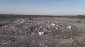 teherautó : garbage on landfill, drone view on man running along city dump household waste and flying seagulls over large rubbish piles Stock mozgókép