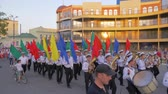 street parade : KHERSON, UKRAINE - MAY 20, 2019: Festival Melpomene of Tavria, orchestra of sailors walking along the main street of the city, students Marine Academy with colorful flags on parade Stock Footage