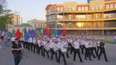 военно морской : KHERSON, UKRAINE - MAY 20, 2019: Festival Melpomene of Tavria, young students Marine Academy march in a parade with musical instruments and colorful flags along the main street of the city Стоковые видеозаписи
