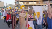 多民族の : KHERSON, UKRAINE - MAY 20, 2019: Festival Melpomene of Tavria, festivities, crowd youth in different costumes with balloons walk along city street and shout chants on open air