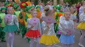 多民族の : KHERSON, UKRAINE - MAY 20, 2019: Festival Melpomene of Tavria, festivity parade, crowd of children in different costumes walk along city street and shout chants outdoors