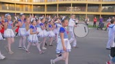 多民族の : KHERSON, UKRAINE - MAY 20, 2019: Festival Melpomene of Tavria, holiday parade, many children in different costumes walk along city street and shout chants on open air
