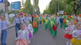 多民族の : KHERSON, UKRAINE - MAY 20, 2019: Festival Melpomene of Tavria, National city event, crowd children and teenagers in different costumes walk along city street and shout chants outdoors