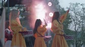 folk : KHERSON, UKRAINE - MAY 20, 2019: Festival Melpomene of Tavria, National festivities, group girls drummers beat drum sticks on drum close-up on holiday event on open air