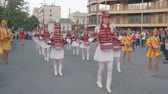 多民族の : KHERSON, UKRAINE - MAY 20, 2019: Festival Melpomene of Tavria, Street performance of festive march of drummers girls in costumes on city street in holiday festival