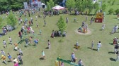 örgütlü : KOZACHI LAGERYA, UKRAINE- JUNE 01, 2019: children public holiday, kids with parents joyfully spend time in parkland during child day celebration Stok Video