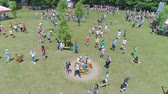 организованный : KOZACHI LAGERYA, UKRAINE- JUNE 01, 2019: public holiday, happy people with children have fun having fun in park with attractions celebrating International Children Day Стоковые видеозаписи