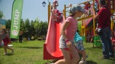 giostre : KOZACHI LAGERYA, UKRAINE- JUNE 01, 2019: children holiday, group of kids actively spend time running and riding on the playground during the summer holiday
