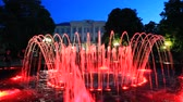 rest : beautiful colored fountains in the city park