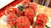przetwory : tomatoes in the jars prepared for preservation