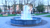 lilac : Colored fountains in city park. Colorful jets of water. Lifestyle concept. People walking in city park with fountains