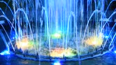 Colored fountains in city park. Colorful jets of water. Lifestyle concept. Colored water in fountains
