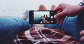 galeria : Point of View: Man and Woman hands Using Smartphone, Taking Feet Picture with Photo App, Slow Motion 4K, DCi. Couple making photos on the beach near lake, creating memories. Social network, technology
