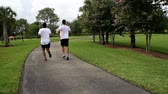 adult : two guys running. training. HD