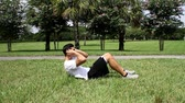 mide : Male exercising abs. sit-ups workout. side view Stok Video