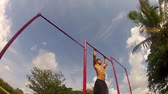 athletic guy pulls on the bar. Pull ups