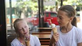 backlit : Young girls eating ice cream outdoors Stock Footage