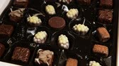 trufas : Delicious chocolate candies in box on table.Assorted Chocolate pralines.