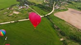 baloon : Hot air balloons in the sky over a field in the countryside. Aerial view