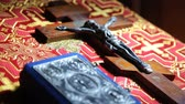 piety : Orthodox items.Orthodox cross with bible in church Stock Footage
