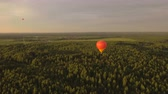 baloon : Hot air balloons in the sky over a field in the countryside.Aerial view:Hot air balloons in the sky over a field in the countryside in the beautiful sky and sunset.