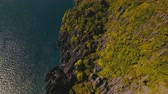 kamie�� : Sea, rocks forest, El Nido.Aerial view: rock with rainforest. Tropical landscape.Mountains rocks. Aerial video.Seascape: mountains, oceanPhilippines El Nido 4K video Travel concept Aerial footage. Wideo
