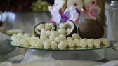 trufas : Half coconut with coconut candies.Candies in coconut flakes and fresh coconut.