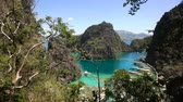 busuanga : Tropical lagoon with azure water, beach by the Kayangan Lake, Philippines. View Coron island, with cove, bay at Kayangan lake. Lagoon with sailing boats. Philippines. 4K video, Travel concept, Aerial footage.