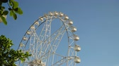 sídlo : Ferris wheel in Manila, Mall of Asia. Ferris wheel against a blue sky. 4K video, Philippines.