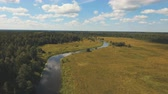 yükseklik : Landscape with river, forest, clouds, blue sky.Aerial view of the water surface of the river.Aerial video.4K,UHD Aerial Rural landscape.