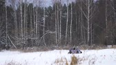 terreno extremo : Winter racing side-by-side vehicles. Rally on the buggy on the snow on a winter day. Racing in the SXS class. Buggy, sports car on rally. Off Road Series racing. Slow motion.