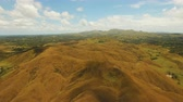 tepelik : Aerial view Beautiful hilly mountains landscape. Big hills on a tropical island Bohol , Philippines. 4K video. Travel concept. Aerial footage.