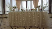 restoran : Festive, decorated banquet hall for weddings. Beautiful elegant wedding reception table arrangement. Tables setting at a luxury wedding hall. Stok Video