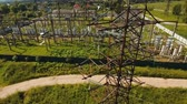изоляция : Aerial view Power plant, transformation station, cables and wires. High voltage electric power substation. Electrical power transformer in high voltage substation, 4K, aerial footage.