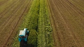 mowing : Tractor mowing green field. Aerial view tractor being used to cut grass at a commercial turf growing farm. Aerial footage, 4K video.