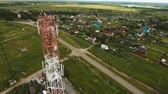 передатчик : Aerial view Cell phone tower. Tower of communications with lot of different antennas. Telecommunication tower. Aerial footage, 4K video