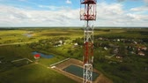 сотовый телефон : Aerial view Cell phone tower. Tower of communications with lot of different antennas. Telecommunication tower. Aerial footage, 4K video