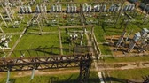 transformador : Aerial view Power plant, transformation station, cables and wires. High voltage electric power substation. Electrical power transformer in high voltage substation, 4K, aerial footage.