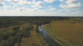 imagens : Landscape with river, forest, clouds, blue sky.Aerial view of the water surface of the river.Aerial video.4K,UHD Aerial Rural landscape.