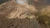 seyahatleri : Crater with active volcano smoke in East Jawa, Indonesia. Aerial view of volcano crater Mount Gunung Bromo is an active volcano,Tengger Semeru National Park. 4K video. Aerial footage. Stok Video