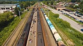 wagons : Passenger train arrives at the railway station. Aerial view train, railway, highway. Aerial drone footage, 4k.