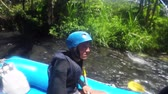 vor : Rafting in the canyon on Balis mountain river. Group of traveler in the inflatable rafting on the river, extreme and fun sport