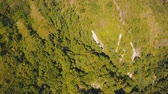 vale : Aerial view of Slopes of the mountains are covered tropical forest. Landscape, mountains, rainforest, trees. Bali,Indonesia. 4K video. Travel concept. Aerial footage.