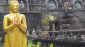 seyahatleri : Statue of the Buddhist God Buddha in the Buddhist temple Brahma Vihara Arama with statues of the gods on Bali island, Indonesia. Bali Architecture, Ancient design. Travel concept.