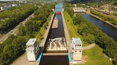 porta de entrada : Sluice Gates on the River. Aerial view barge, ship in the river gateway. River sluice construction, water river gateway. Shipping channel. 4K, flying video, aerial footage Vídeos