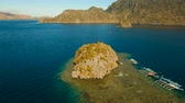 busuanga : Aerial view: beach, tropical island, sea bay and lagoon, mountains with rainforest, Palawan. Lagoon with blue, azure water in the middle of small islands and rocks. Busuanga. Seascape, tropical landscape. Aerial video. Philippines. 4K video Travel concept Stock Footage