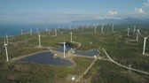 바람 : Aerial view of Windmills for electric power production on the seashore. Bangui Windmills in Ilocos Norte, Philippines. Solar farm, Solar power station. Ecological landscape: Windmills, sea, mountains.